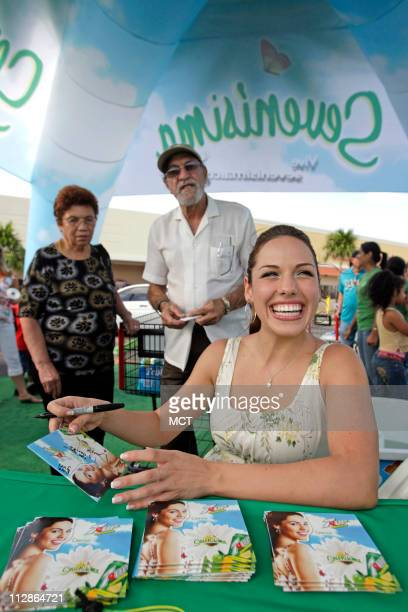 Singer Denise Gonzalez signs autographs for fans as she promotes her music CD and 7UP on Friday July 31 in Miami Florida An increasing number of...