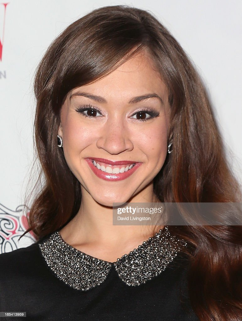 Singer Diana DeGarmo attends iiJin's Fall/Winter 2013 'The Love Revolution' fashion show at Avalon on April 3, 2013 in Hollywood, California.