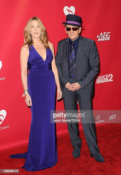 Singer Diana Krall and musician Elvis Costello arrive at the 2012 MusiCares Person of the Year Tribute to Paul McCartney held at the Los Angeles...