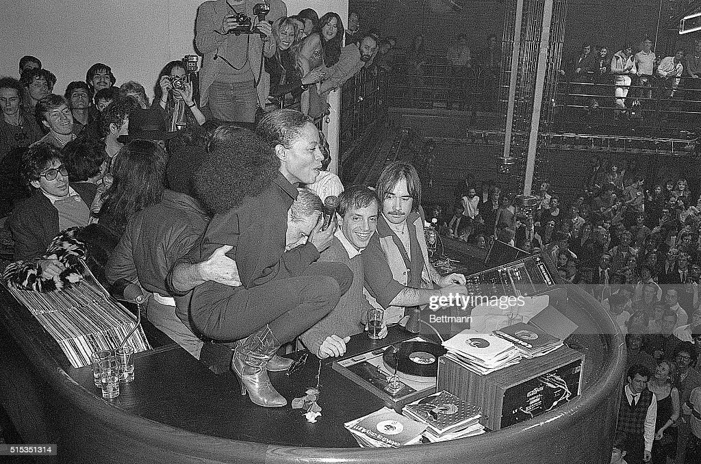 Singer Diana Ross squatting atop disc jockey booth in Studio 54 entertains merrymakers at farewell party for coowners Steve Rubell and his partner...
