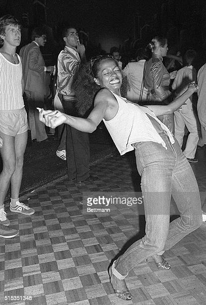 Singer Diana Ross who first became popular as a member of the Supremes makes a limbolike move on a New York dance floor while in town for an...