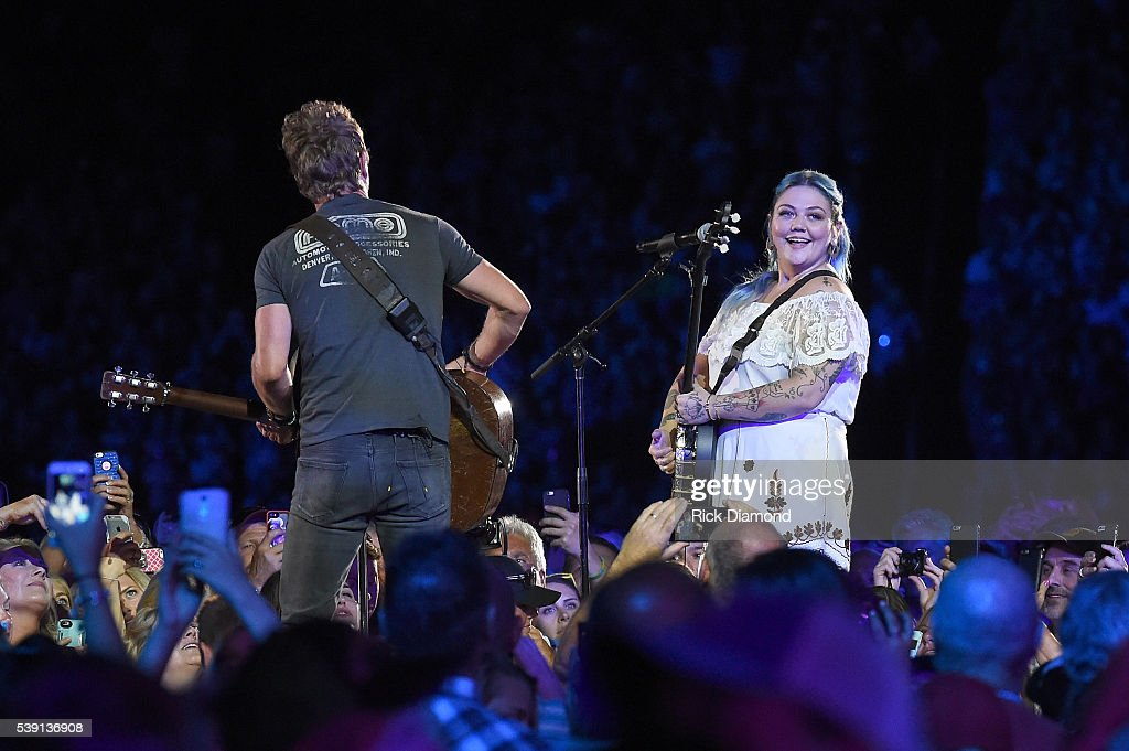 Singer Dierks Bentley and singersongwriter Elle King performs onstage during 2016 CMA Festival Day 1 at Nissan Stadium on June 9 2016 in Nashville...