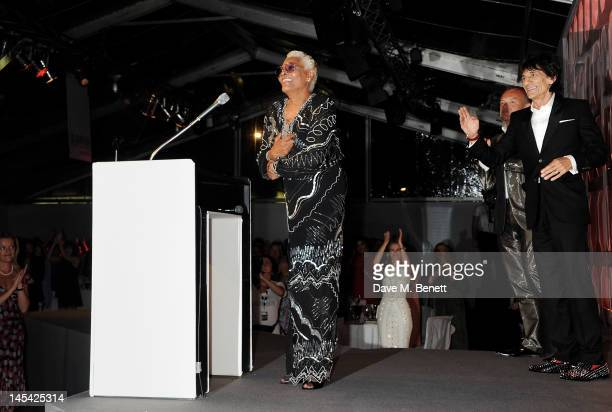Singer Dionne Warwick accepts her award from host Graham Norton and presenter Ronnie Wood at the Glamour Women of the Year Awards in association with...