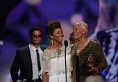 Singer Dionne Warwick accepts the Legend Award from singer Gladys Knight onstage at the Soul Train Awards 2013 at the Orleans Arena on November 8...