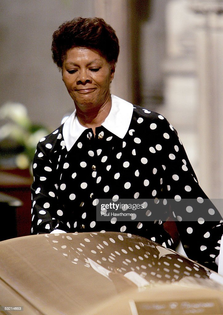 Singer Dionne Warwick pays tribute to Luther Vandross' casket during the funeral of Vandross at Riverside Church July 8, 2005 in New York City.