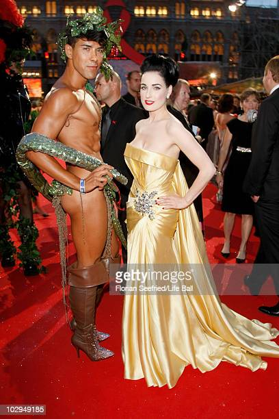 Singer Dita von Teese poses with dancer Oscar Loya during the 18th Life Ball at the Town Hall on July 17 2010 in Vienna Austria The Life Ball is an...