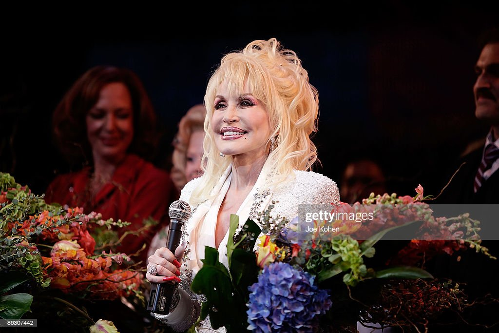 Singer Dolly Parton on stage during curtain call at the opening of '9 to 5: The Musical' on Broadway at the Marriott Marquis Theatre on April 30, 2009 in New York City.