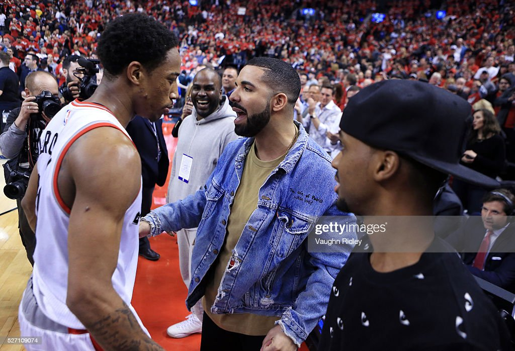 Singer <a gi-track='captionPersonalityLinkClicked' href=/galleries/search?phrase=Drake+-+Entertainer&family=editorial&specificpeople=6927008 ng-click='$event.stopPropagation()'>Drake</a> congratulates DeMar DeRozan #10 of the Toronto Raptors following Game Seven of the Eastern Conference Quarterfinals against the Indiana Pacers during the 2016 NBA Playoffs at the Air Canada Centre on May 01, 2016 in Toronto, Ontario, Canada.