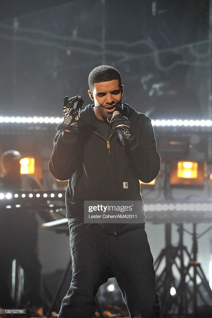 Singer <a gi-track='captionPersonalityLinkClicked' href=/galleries/search?phrase=Drake+-+Entertainer&family=editorial&specificpeople=6927008 ng-click='$event.stopPropagation()'>Drake</a> onstage at the 2011 American Music Awards held at Nokia Theatre L.A. LIVE on November 20, 2011 in Los Angeles, California.
