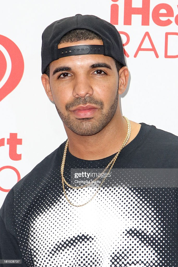 Singer <a gi-track='captionPersonalityLinkClicked' href=/galleries/search?phrase=Drake+-+Entertainer&family=editorial&specificpeople=6927008 ng-click='$event.stopPropagation()'>Drake</a> poses in the iHeartRadio music festival photo room on September 21, 2013 in Las Vegas, Nevada.