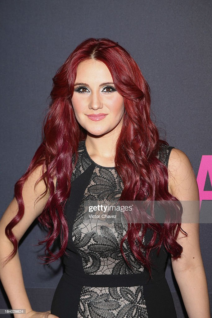 Singer Dulce Maria attends the Glamour Magazine 15th Anniversary at Casino Del Bosque on October 10, 2013 in Mexico City, Mexico.