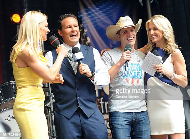 Singer Dustin Lynch appears on stage with TV personalities Anna Kooiman Brian Kilmeade and Ainsley Earhardt during 'FOX Friends' All American Concert...