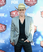 Singer Dustin Lynch arrives at the American Country Awards 2013 at the Mandalay Bay Events Center on December 10 2013 in Las Vegas Nevada