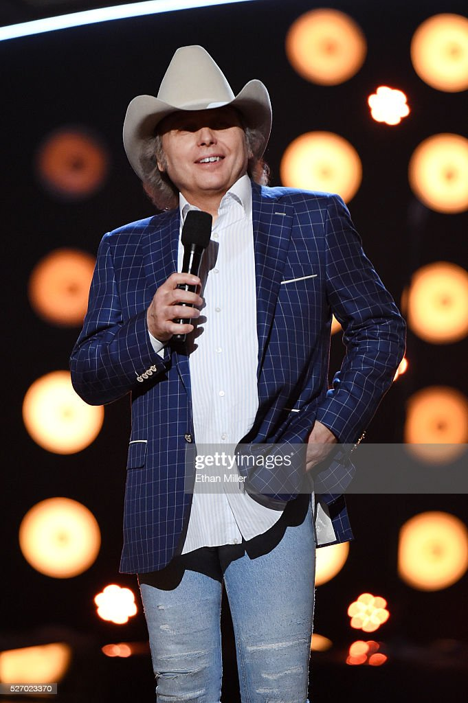 Singer <a gi-track='captionPersonalityLinkClicked' href=/galleries/search?phrase=Dwight+Yoakam&family=editorial&specificpeople=211566 ng-click='$event.stopPropagation()'>Dwight Yoakam</a> speaks onstage during the 2016 American Country Countdown Awards at The Forum on May 1, 2016 in Inglewood, California.