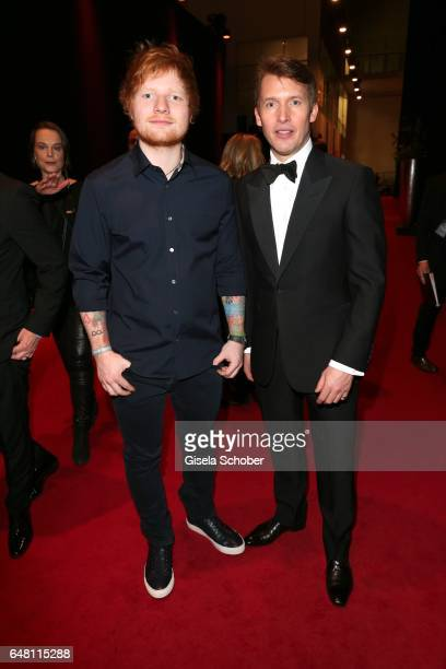 Singer Ed Sheeran and singer James Blunt during the Goldene Kamera reception at Messe Hamburg on March 4 2017 in Hamburg Germany