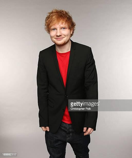 Singer Ed Sheeran poses at the Wonderwall portrait studio during the 2013 CMT Music Awards at Bridgestone Arena on June 5 2013 in Nashville Tennessee