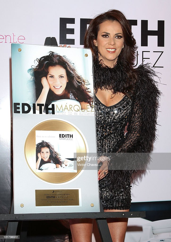 Singer <a gi-track='captionPersonalityLinkClicked' href=/galleries/search?phrase=Edith+Marquez&family=editorial&specificpeople=5971767 ng-click='$event.stopPropagation()'>Edith Marquez</a> is handling a gold disc for more than 30,000 sales of his new album 'Amar No Es Suficiente' during a photocall and press conference at the Nikko Polanco Hotel on November 7, 2011 in Mexico City, Mexico.