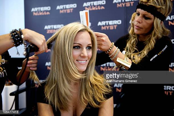 Singer Edurne changes her look during a live show at 'Feria Salon Look Internacional de Madrid' on October 15 2010 in Madrid Spain