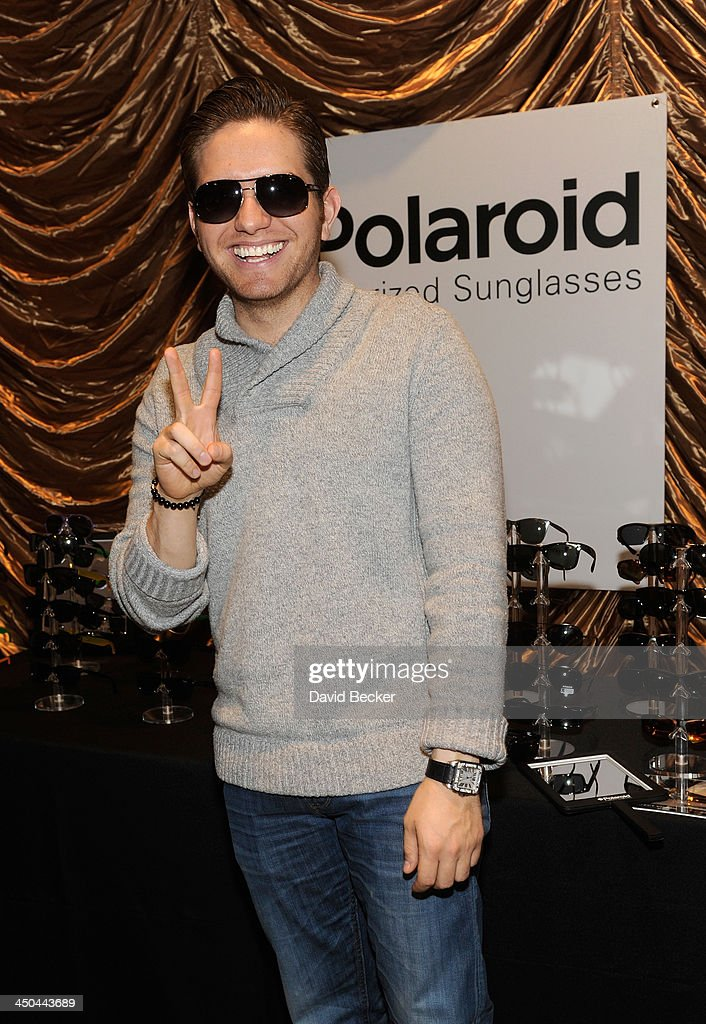 Singer El Dasa with Polaroid Polarized Sunglasses at a gift lounge during the 14th annual Latin GRAMMY Awards at the Mandalay Bay Events Center on November 18, 2013 in Las Vegas, Nevada.