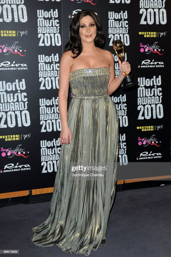 Singer <a gi-track='captionPersonalityLinkClicked' href=/galleries/search?phrase=Elissa&family=editorial&specificpeople=641088 ng-click='$event.stopPropagation()'>Elissa</a> poses backstage after she received an award during the World Music Awards 2010 at the Sporting Club on May 18, 2010 in Monte Carlo, Monaco.