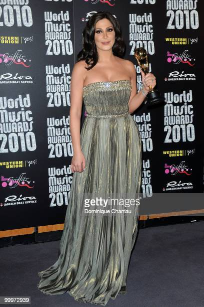 Singer Elissa poses backstage after she received an award during the World Music Awards 2010 at the Sporting Club on May 18 2010 in Monte Carlo Monaco