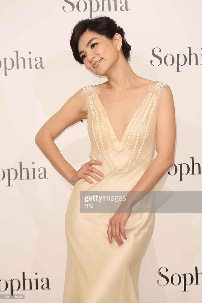 Singer Ella attends opening ceremony of wedding shop on Tuesday November 19,2013 in Taipei,China.