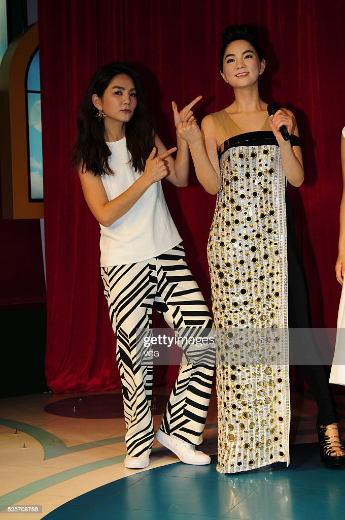 Singer <a gi-track='captionPersonalityLinkClicked' href=/galleries/search?phrase=Ella+Chen&family=editorial&specificpeople=4386724 ng-click='$event.stopPropagation()'>Ella Chen</a> of girl group S.H.E poses with her wax figure at the Madame Tussaud's Shanghai on May 29, 2016 in Shanghai, China.
