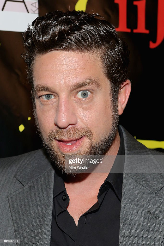 Singer <a gi-track='captionPersonalityLinkClicked' href=/galleries/search?phrase=Elliott+Yamin&family=editorial&specificpeople=564519 ng-click='$event.stopPropagation()'>Elliott Yamin</a> arrives at iiJin's Spring/Summer 2014 'The Glamorous Life' clothing and footwear collection fashion show at Avalon on October 16, 2013 in Hollywood, California.