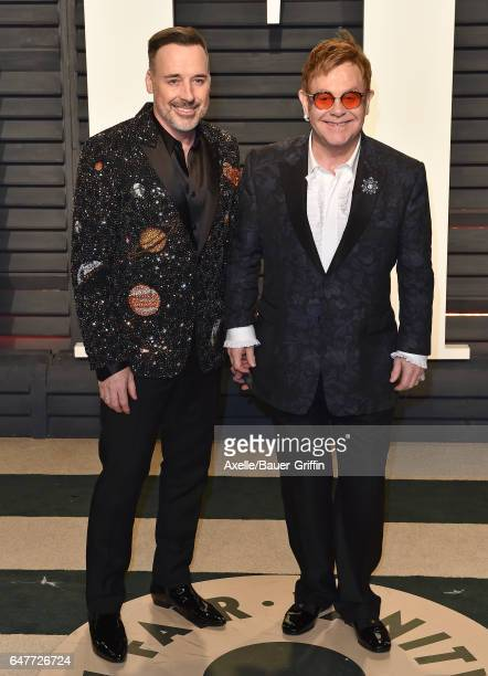 Singer Elton John and David Furnish arrive at the 2017 Vanity Fair Oscar Party Hosted By Graydon Carter at Wallis Annenberg Center for the Performing...