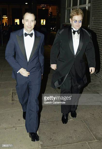 Singer Elton John and David Furnish attend the launch of David Bailey's new book 'David Bailey Locations' at Lowes Advertising on December 11 2003 in...