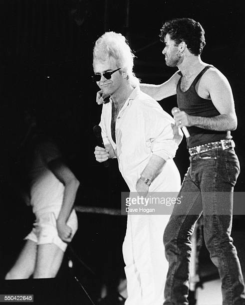 Singer Elton John and George Michael performing together on stage at the 'Wham' farewell concert at Wembley Stadium London July 8th 1986