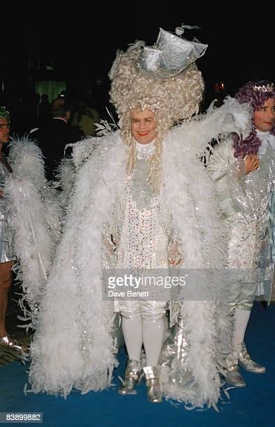 Singer Elton John dressed in a period ensemble for his 50th birthday party at Hammersmith Palais 6th April 1997
