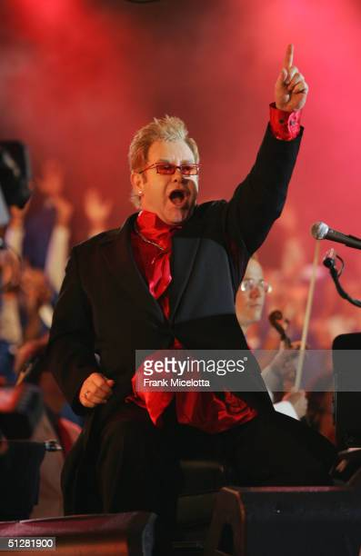 Singer Elton John performs with the Boston Pops Orchestra before the NFL opening game between the Indianapolis Colts vs the New England Patriots at...