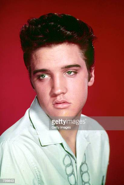 Singer Elvis Presley poses for a studio portrait