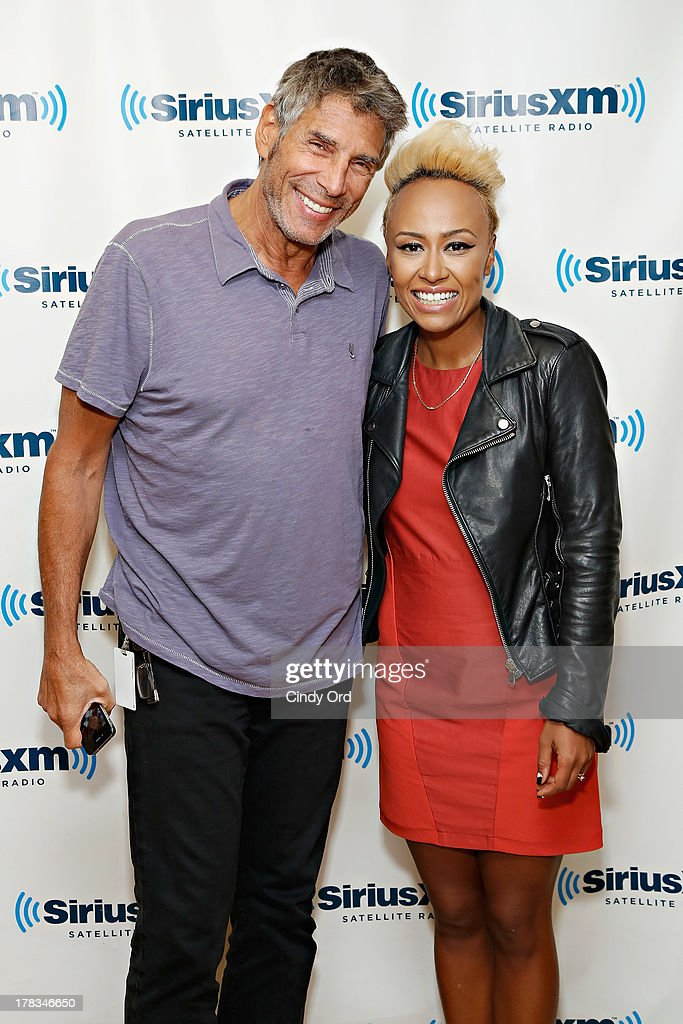 Singer Emeli Sande (R) poses with SiriusXM host Mark Goodman at the SiriusXM Studios on August 29, 2013 in New York City.