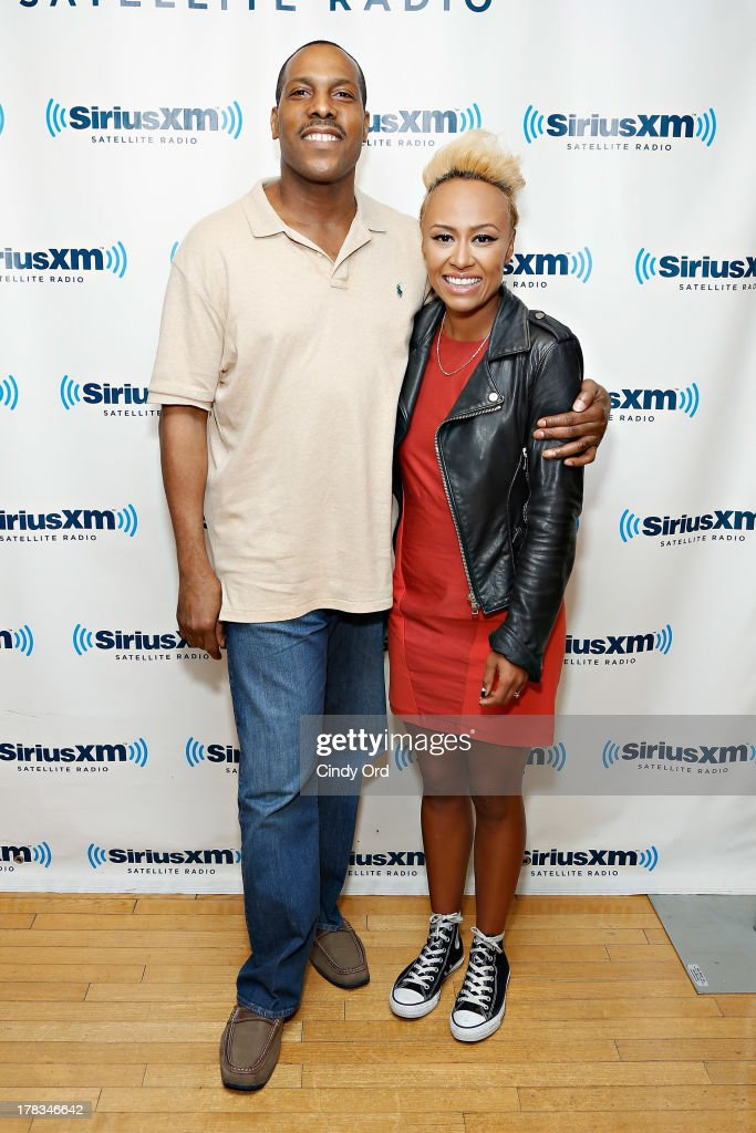 Singer Emeli Sande (R) poses with SiriusXM host Mike Shannon at the SiriusXM Studios on August 29, 2013 in New York City.