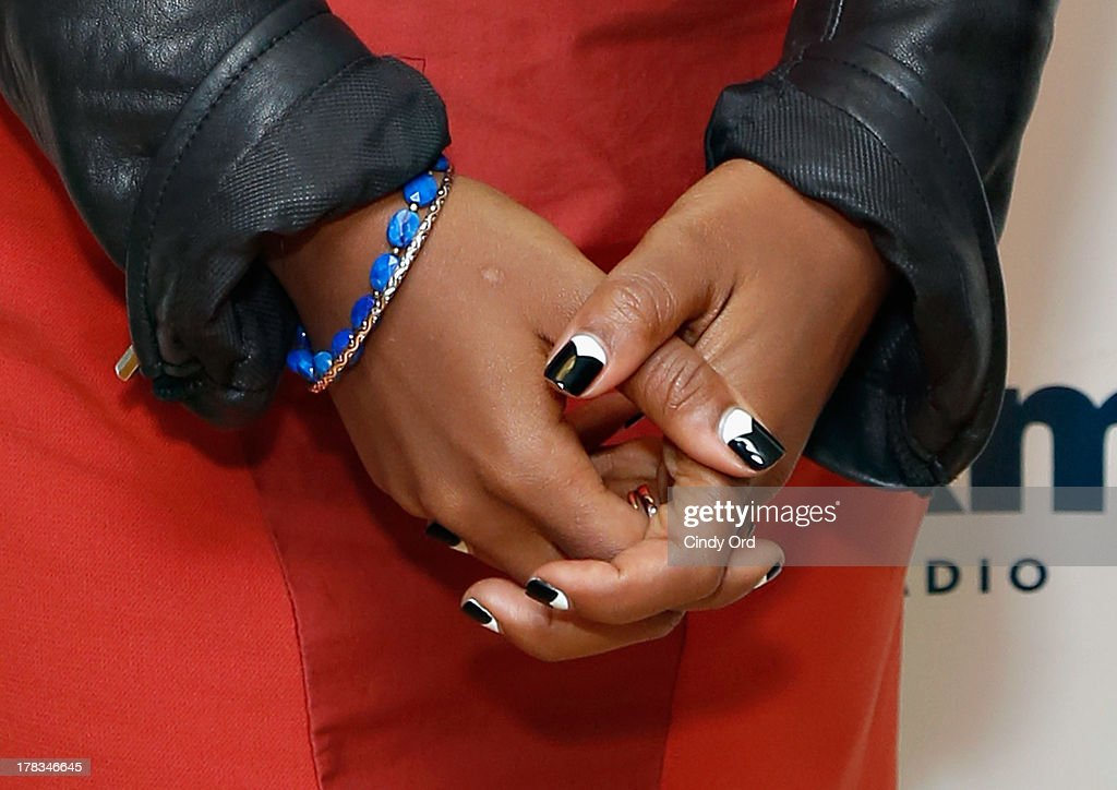 Singer Emeli Sande (jewelry/ nail polish detail) visits the SiriusXM Studios on August 29, 2013 in New York City.