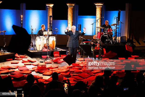 Singer Enrico Macias during the traditional throw of cushions at the final of his concert at the 30th Ramatuelle Festival Day 10 on August 10 2014 in...