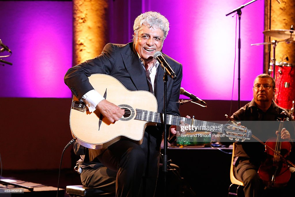 Singer <a gi-track='captionPersonalityLinkClicked' href=/galleries/search?phrase=Enrico+Macias&family=editorial&specificpeople=2057443 ng-click='$event.stopPropagation()'>Enrico Macias</a> gives a concert at the 30th Ramatuelle Festival : Day 10 on August 10, 2014 in Ramatuelle, France.