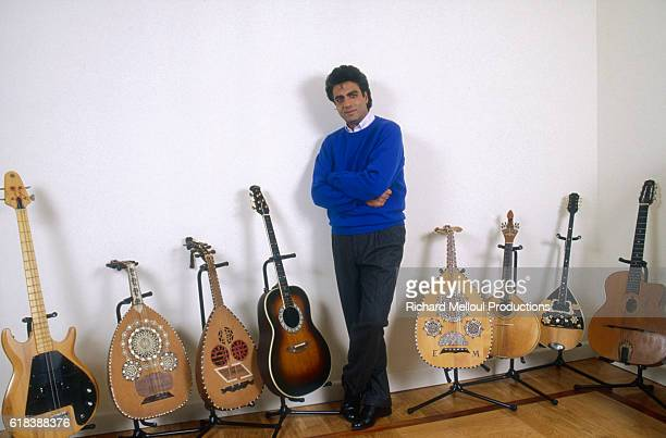 Singer Enrico Macias poses with his guitar collection in Paris