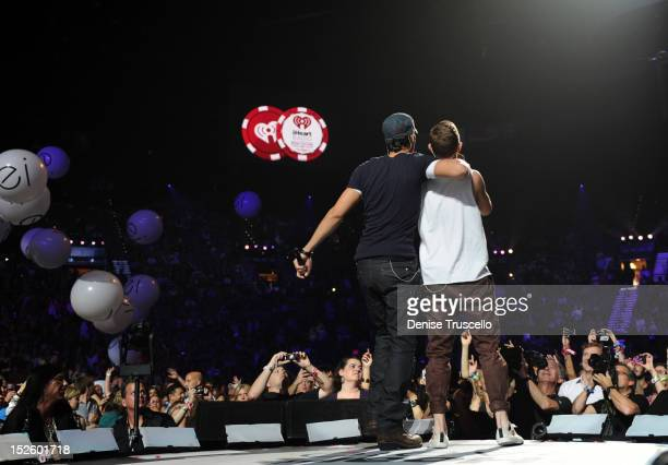 Singer Enrique Iglesias and Recording artist Sammy Adams perform performs onstage during the 2012 iHeartRadio Music Festival at the MGM Grand Garden...