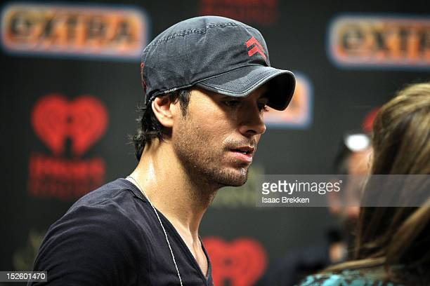 Singer Enrique Iglesias appears backstage during the 2012 iHeartRadio Music Festival at the MGM Grand Garden Arena on September 22 2012 in Las Vegas...