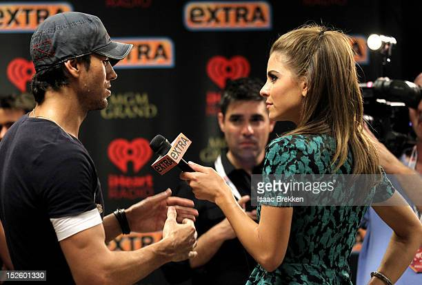 Singer Enrique Iglesias is interviewed by television personality Maria Menounos backstage during the 2012 iHeartRadio Music Festival at the MGM Grand...