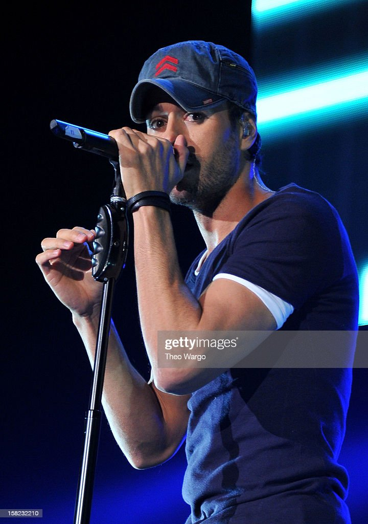 Singer <a gi-track='captionPersonalityLinkClicked' href=/galleries/search?phrase=Enrique+Iglesias+-+Singer&family=editorial&specificpeople=202672 ng-click='$event.stopPropagation()'>Enrique Iglesias</a> performs onstage during Hot 99.5's Jingle Ball 2012, presented by Charleston Alexander Diamond Importers, at The Patriot Center on December 11, 2012 in Washington, D.C.