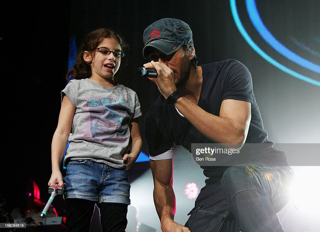 Singer Enrique Iglesias (R) performs onstage during Power 96.1's Jingle Ball 2012 at the Philips Arena on December 12, 2012 in Atlanta.