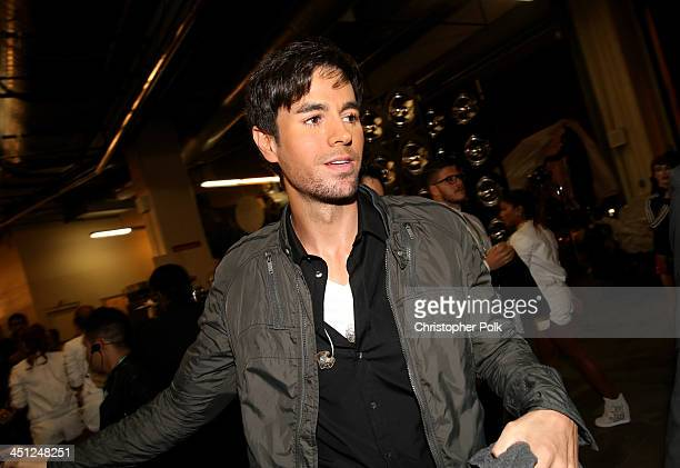 Singer Enrique Iglesias poses backstage during the 14th Annual Latin GRAMMY Awards held at the Mandalay Bay Events Center on November 21 2013 in Las...