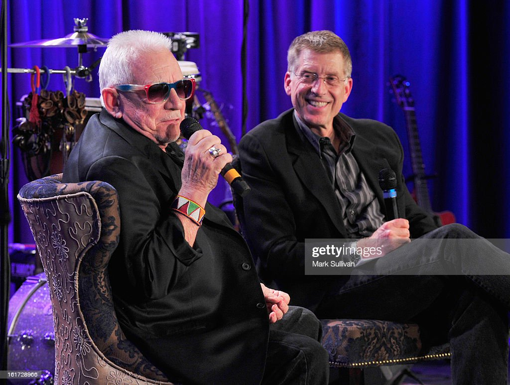 Singer Eric Burdon (L) and GRAMMY Museum executive director Bob Santelli onstage during An Evening With Eric Burdon at The GRAMMY Museum on February 14, 2013 in Los Angeles, California.