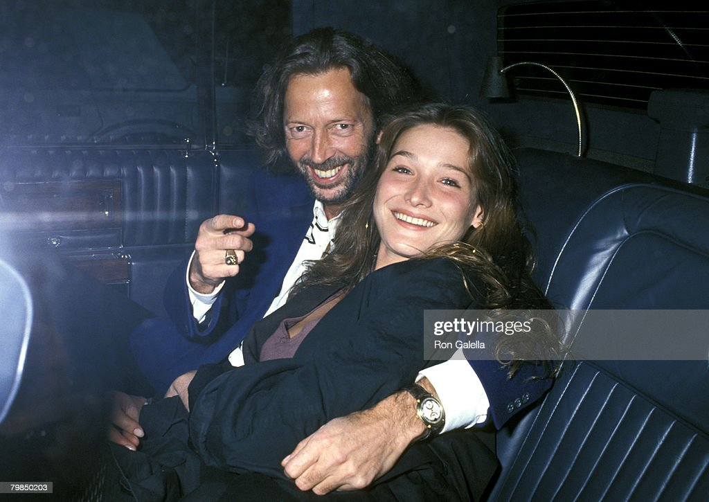 Singer Eric Clapton and model <a gi-track='captionPersonalityLinkClicked' href=/galleries/search?phrase=Carla+Bruni&family=editorial&specificpeople=235729 ng-click='$event.stopPropagation()'>Carla Bruni</a> arrive at 'Bill Wyman's Birthday Party' on October 24, 1989 at Red Zone in New York City, New York.
