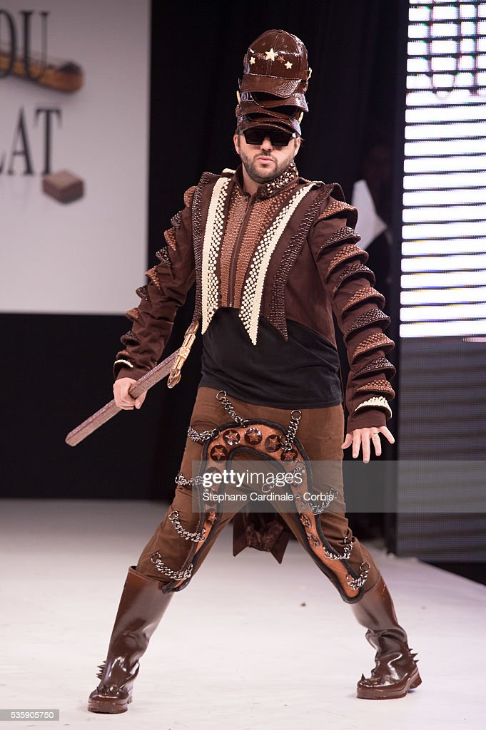 Singer Eric Greff a.k.a Helmut Fritz walks the runway and wears chocolate creations made by designer Nathalie Erkan and chocolate maker Franck Kestener during the Fashion Chocolate Show at Salon du Chocolat at Porte de Versailles, in Paris.