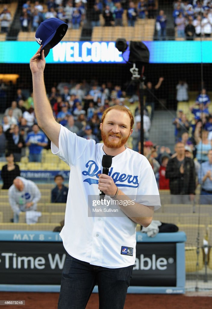 Singer Eric Paslay sings the national anthem before the game between the Philadelphia Phillies and the Los Angeles Dodgers at Dodger Stadium on April...
